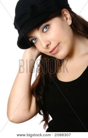105 Beautiful Woman With Blue Eyes In Black Hat And Black Casual Top Isolated
