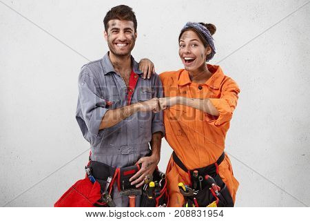 Happy Team Of Service Workers Rejoice Successful Finishing Work. Smiling Male Carpenter In Special U