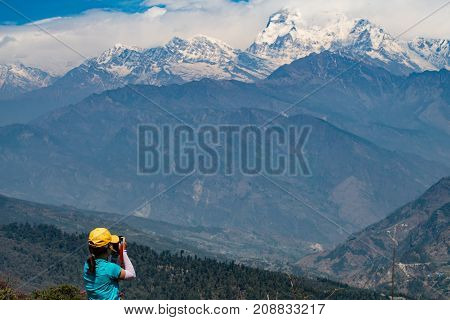 Asian girl travel in Nepal with Himalaya range in the background.