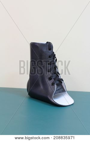 Black leather lace up ankle brace quarter turn