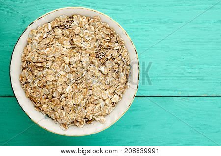 Oatmeal With Nuts. Oatmeal On A Wooden Table.