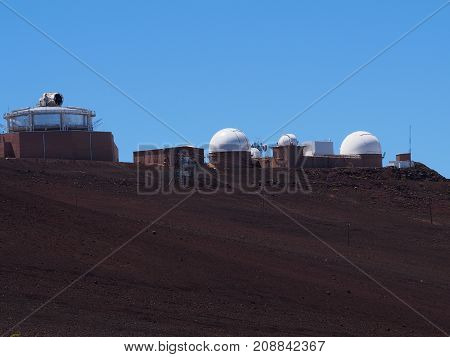 Observatories on top of Haleakala mountain peak.