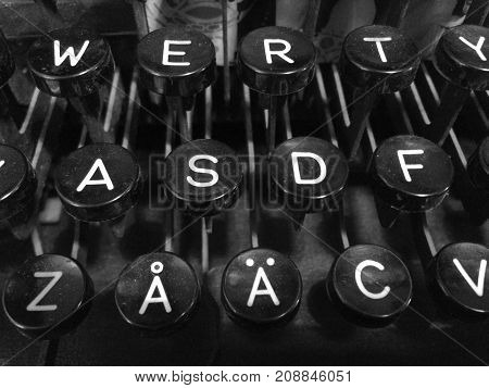 Finnish vintage typewriter including uppercase letter A with ring, letter A with diaeresis, QWERTY, and ASDF keys.