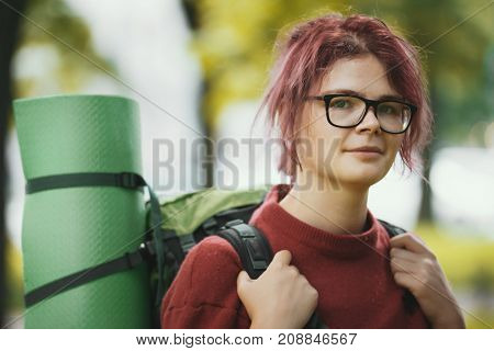 Portrait of a girl teenager tourist with backpack outdoor, telephoto shot