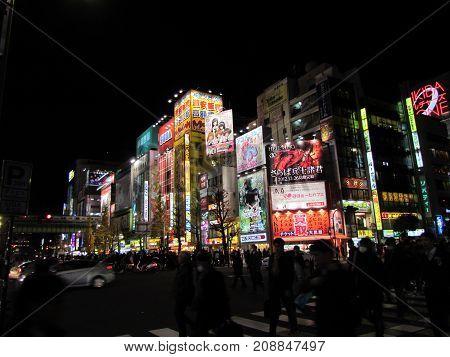 Akihabara Tokyo Japan, 23 December 2012: Night scenery with Neon signs and billboard advertisements in Akihabara electronics hub in Tokyo