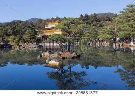 Golden pavilion Kinkakuji temple in public park Kyoto Japan landmark