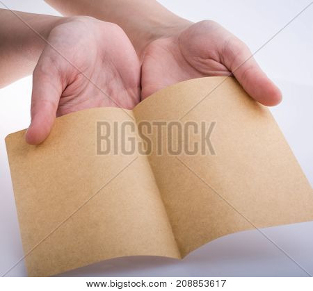 Hand Holding A Brown Color Paper