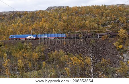 ORE LINE, NORWAY ON SEPTEMBER 14. View of an Iron Ore train moves down the mountainside towards Narvik on September 14, 2017 in Oladalen, Norway. Editorial use.