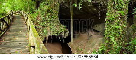 Boardwalk and small cave in Niah national park Borneo Malaysia