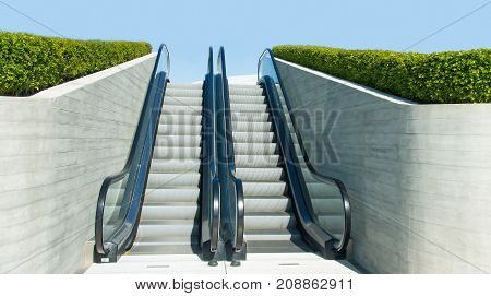 Front view of modern escalators in outdoor public place