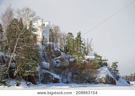 View of the old Ludwigstein chapel in the Monrepo park on a cloudy February day. Vyborg, Russia
