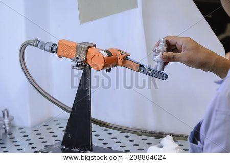 The aluminium casting part in the post production process.The aluminium automotive part.