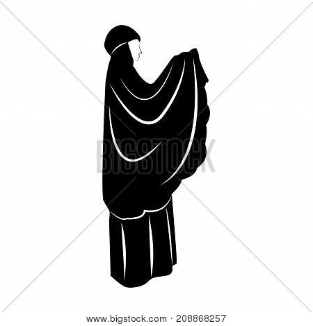 Traditionally clothed muslim woman making a supplication (salah) while standing on a praying rug against