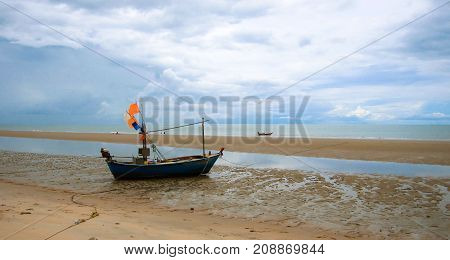 Fishing boat parked at the beach in Thailand.