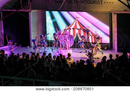 Yalta, Crimea - 11 July, Theatrical performance of teenage girls on stage., 11 July, 2017. Performance of young artists on the stage of the hotel Yalta Intourist.