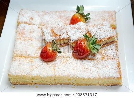 close up of fruit cake and strawberry