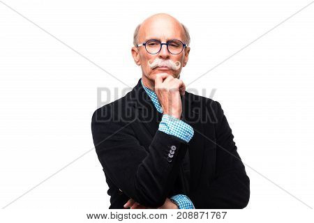 Thoughtful Mature Man On White Background. Thoughtful Senior Man In Formalwear Holding Hand On Chin