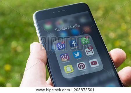 Sankt-Petersburg Russia October 13 2017: iphone 6 plus with icons of social media in men hands. Smartphone life style smartphone. Starting social media app.