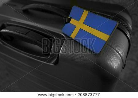 Travelling luggage bag / case with Swedish flag on it