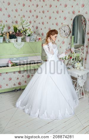 Romantic atmosphere of the bride's morning Portrait of the bride in the mirror by the window