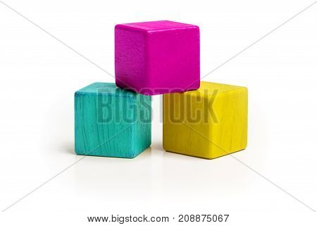 Toy Cube Blocks CMYK Color Isolated over White Background Three Kids Wood Toys Cyan Magenta Yellow colors