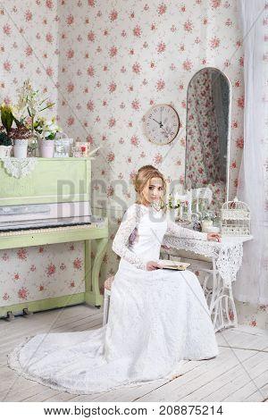 Beautiful bride posing in wedding dress in a white photo Studio.