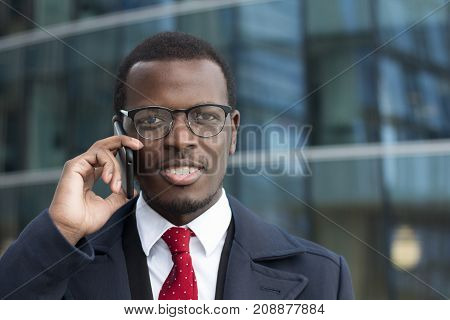 Horizontal Portrait Of Young Dark-skinned Business Guy Dressed In Formal Clothes While Standing In S