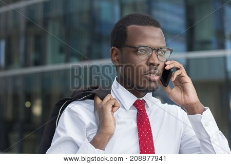 Outdoor Closeup Of Young Dark-skinned Business Guy Wearing White Formal Shirt, Red Tie And Black-rim