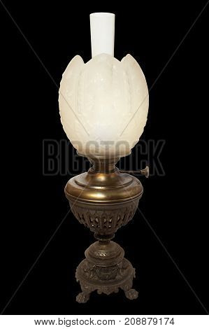 The Old, Shabby Sweatched Kerosene Lamp. The Lamp Of Past Times. Isolated On A Black Background. Mad