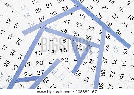 The Many blue and white calendar sheets.