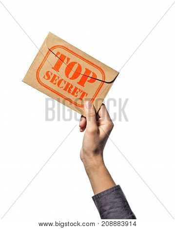 Envelope with stamp top secret in the human hand. Isolated on white background.