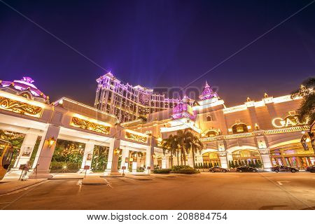 Macau, China - December 8, 2016: Golden shining Galaxy hotel and casino in Cotai Strip of Macau at night. Macau is now gambling capital of Asia and visited by over 25 million people every year.