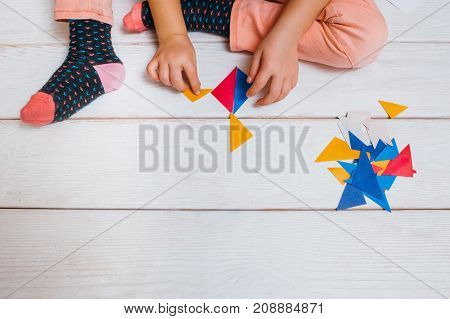 Creative colorful craft. Childhood art. Early children education, unrecognizable child artist top view on wooden background with free space, creativity concept