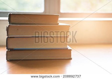 Book On Wood Table. Textbook Beside Window. Education, Study Concept