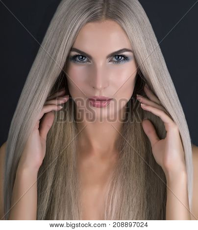 Caucasian girl with blue eyes and gray hair close up shot