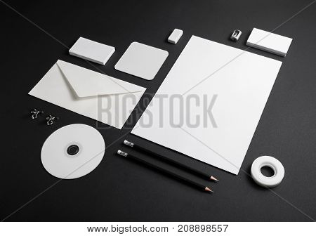 Blank corporate stationery on black paper background. Branding mock-up for placing your design.