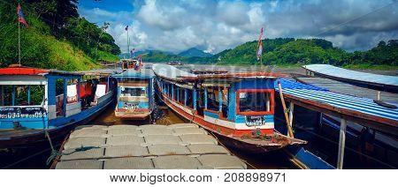 LUANG PRABANG LAOS JUNE 25 2016 : Tour boats at the shore of the Mekong River to bring tourists to cruise in Luang Prabang Laos