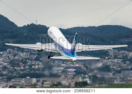 OSAKA, JAPAN - AUG. 14, 2017: Boeing 767-300 taking off from the Itami International Airport in Osaka, Japan.