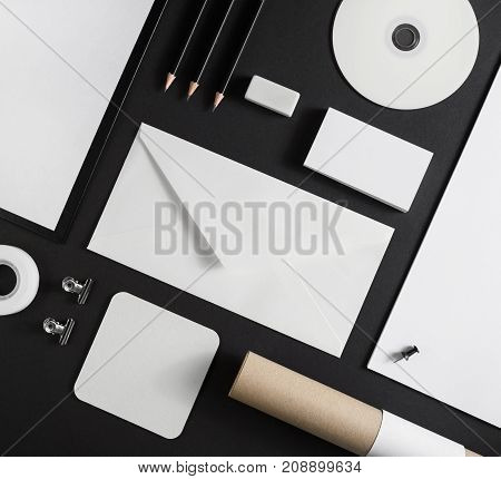 Business brand template on black paper background. Blank corporate stationery set.