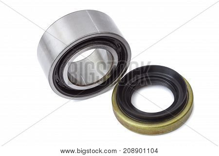 Spare parts for cars bearing and oil seal isolated on white background