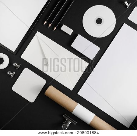 Photo of blank stationery and corporate identity template on black background. For design presentations and portfolios.