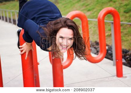 young brunette woman having fun at park in autumn