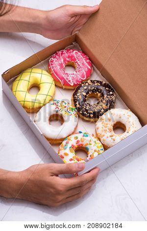 Colored Donuts With Glaze. Assorted Doughnuts With Different Fillings In The Box