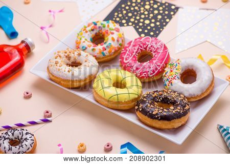 Party. Colourful Round Glazed Donuts And Bottles Of Drinks On Pink Background.