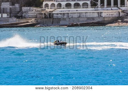 Yalta, Crimea - 11 July, Aquabikeer on the bend, 11 July, 2017. Various types of coastline near the city of Yalta.