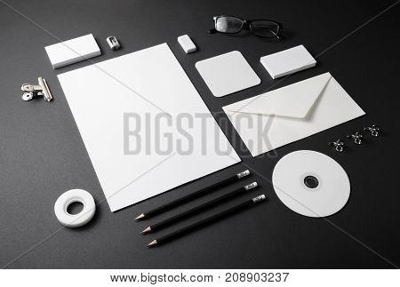 Blank stationery template on black background. Mock-up for branding identity. For design presentations and portfolios.