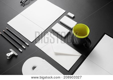 Blank corporate identity set on black paper background. Mockup for design presentations and portfolios.