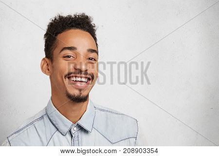Smiling Bearded Man With Oval Face, Trendy Hairstyle, Being Glad To Hear Pleasant Comments From Clie