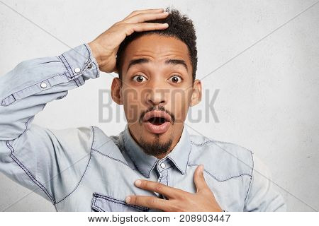 Stunned Amazed African Student Looks At Schedule With Bugged Eyes, Realizes That He Missed One Lectu