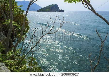Sea view from the mountain. Waves and an island in the sea. Montenegro. The Budva Riviera